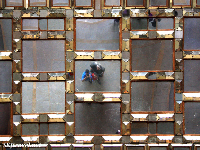 Shara, Erik and Reza looking up into a mirrored ceiling at Chehel Sutun (Forty Column) Palace. Isfahan, Iran.