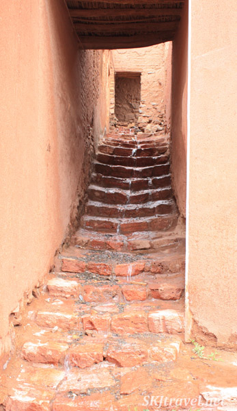Water running down a stone stairway in Abyaneh village, Iran.