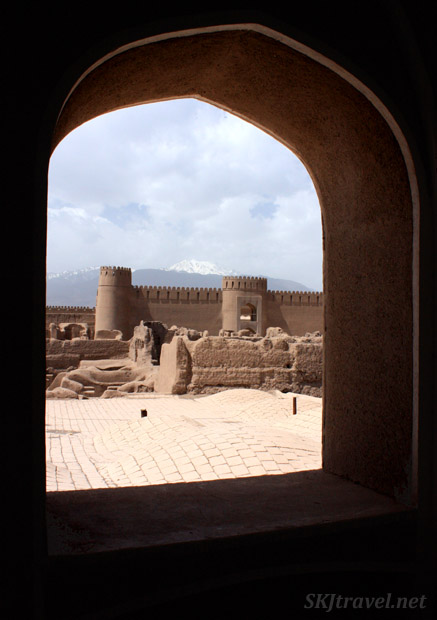 Looking through a window in the outer wall across the citadal of Rayen. Iran.