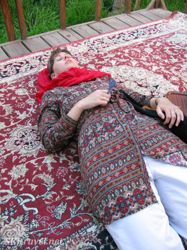 Lying on a carpet after eating icecream. Iran.
