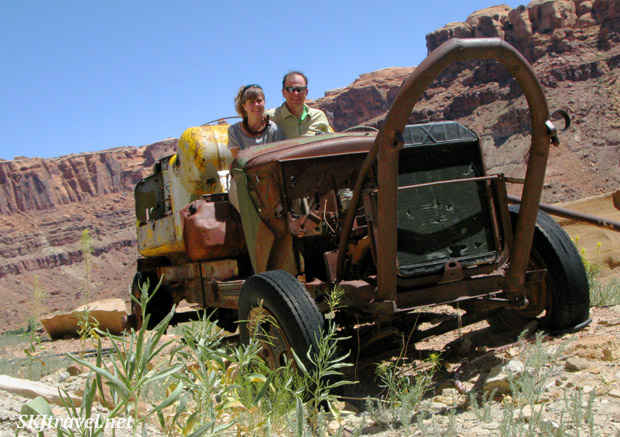 Shara and Erik sitting inside a very old mining vehicle near an abandoned uranium mine along the Green River, Utah.