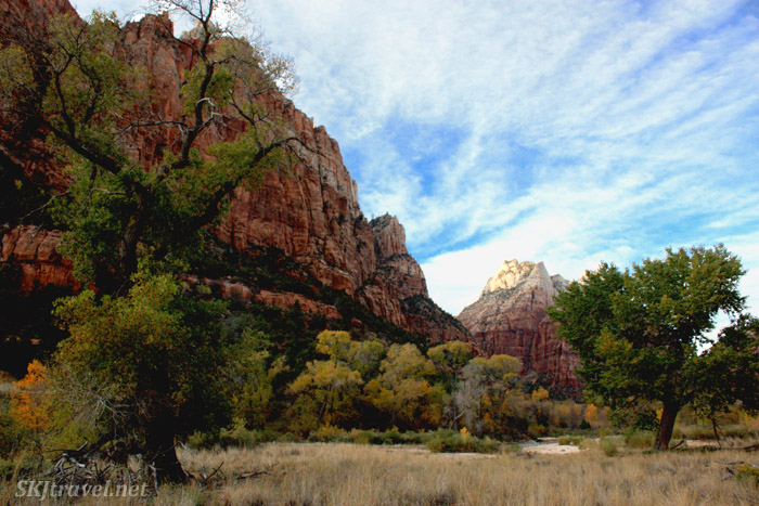 Red rock faces under clouded blue sky. Zion NP