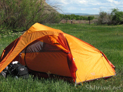 Tent pitched in a grassy meadow beside the Yampa River, Colorado. Photo by Shara Johnson