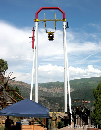 Shara riding the Big Canyon Swing at Glenwood Caverns amusement park, Glenwood Springs, Colorado.