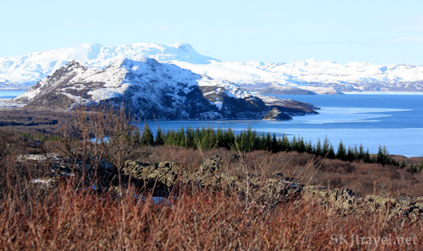 Lake with snow-covered hills in Iceland, part of Golden Triangle route. Photo by Shara Johnson