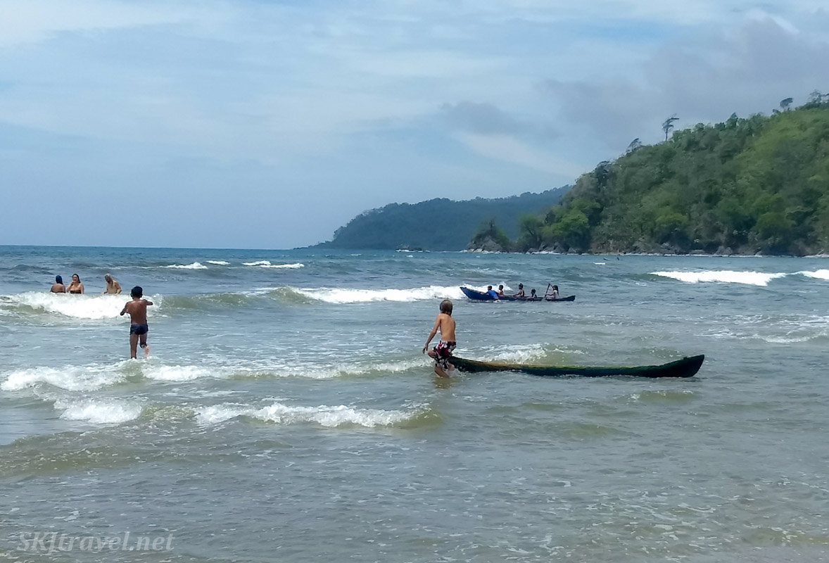 Kids practicing their canoeing skills in the ocean, Armila, Guna Yala, Panama.