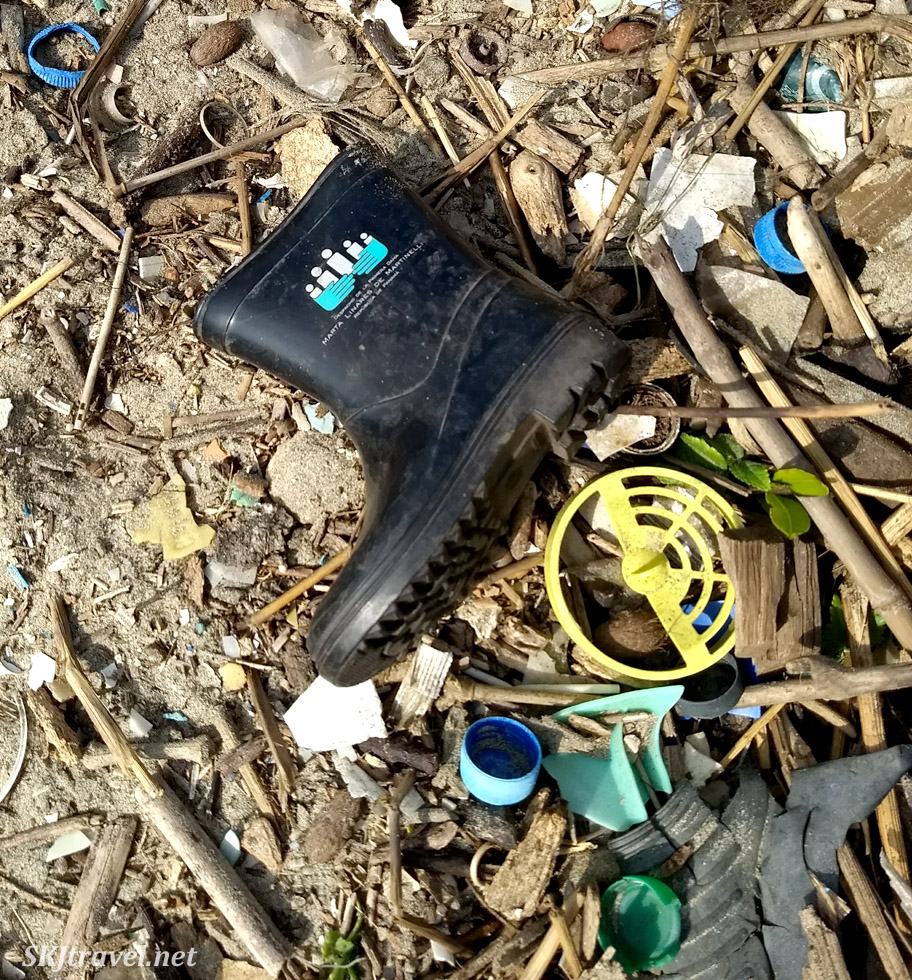 Child's rubber boot among the heaps of trash along the beaches of Armila, Guna yala, Panama.