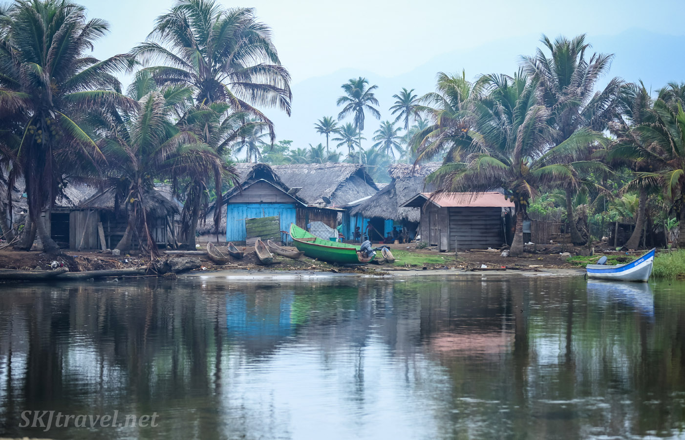 Village huts on the banks of the Armila River. Armila, Panama.