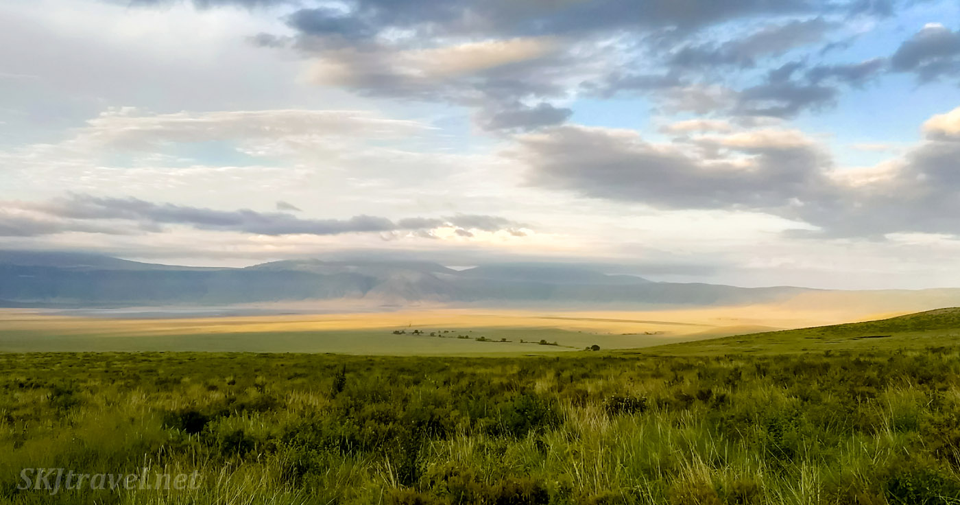 Sunlight spreading across the caldera at dawn, Ngorongoro Crater, Tanzania.