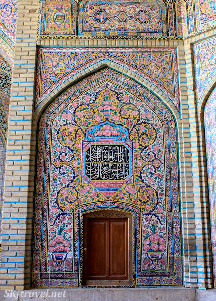 Wooden door in painted wall, Nasir-al-Molk mosque, Shiraz, Iran.