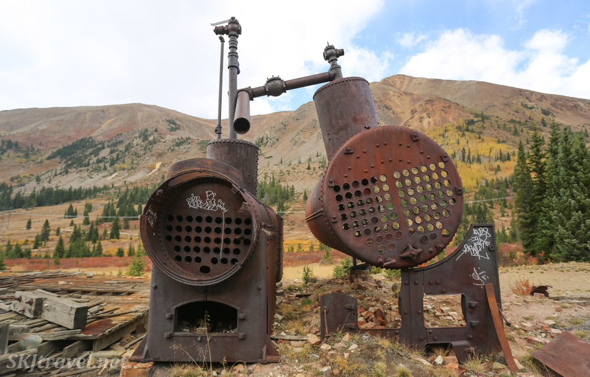 Rusting equipment outside collapsing remains of Pennsylvania Mill, September 2020, off Peru Creek Road, Montezuma, Colorado.