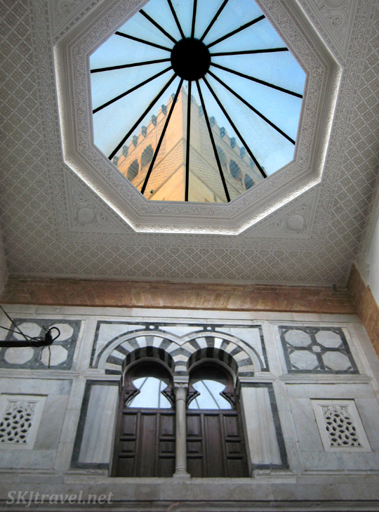 The Great Mosque of Kairouan seen through a window in the medina of Kairouan, Tunisia.