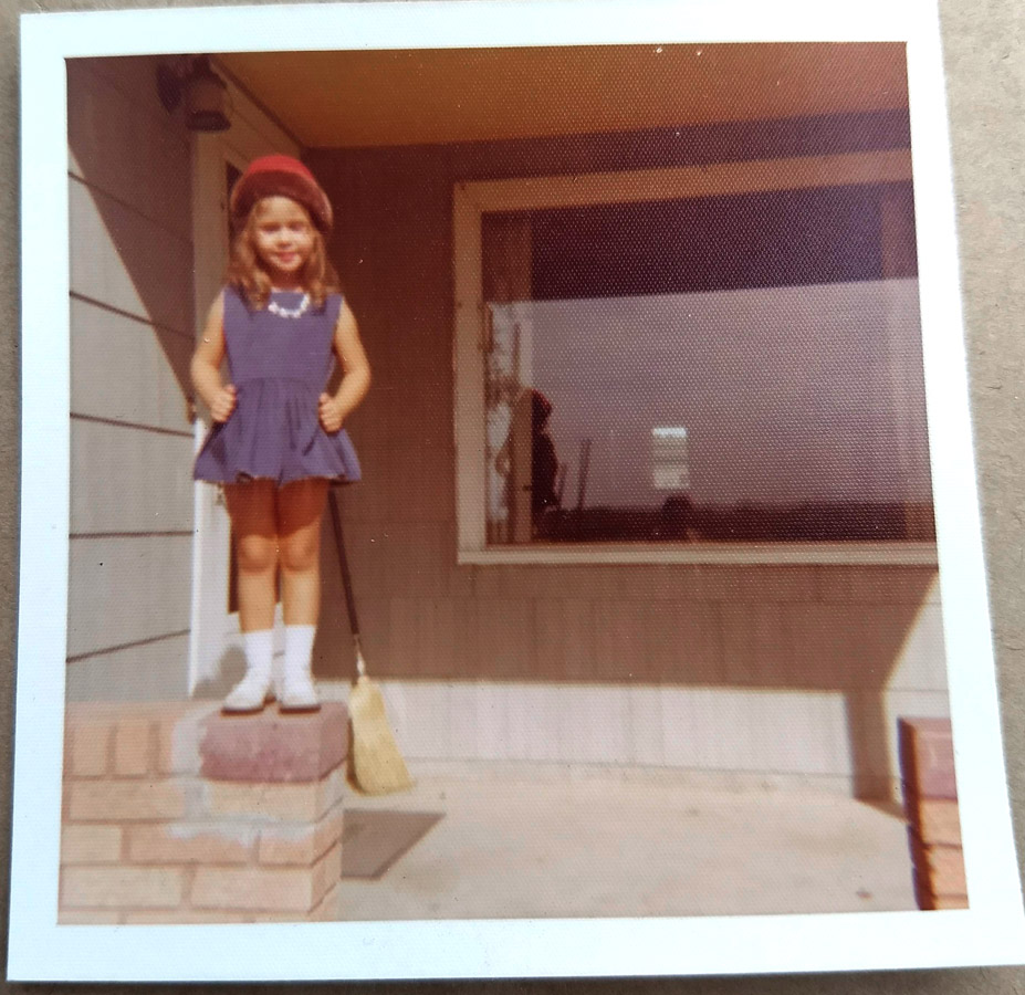 Me standing on the porch of my grandparents' house, early 1970s, Cozad, Nebraska.
