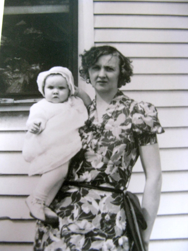 Grandma holding my mom as an infant.