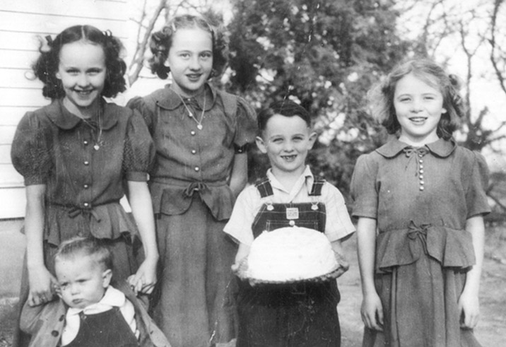 My mom and all her siblings, three girls dressed alike in clothes their grandmother made for them. Maack family, 1940s, Cozad, Nebraska.