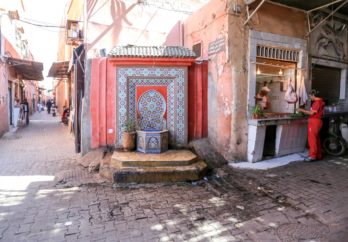 Public water spigot and basin, medina in Marrakech, Morocco.
