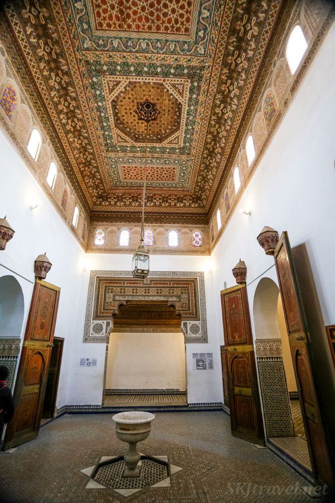 Bahia Palace, Marrakech, Morocco. Inner room with fountain, skylights and elaborate painted ceiling.UNESCO World Heritage.