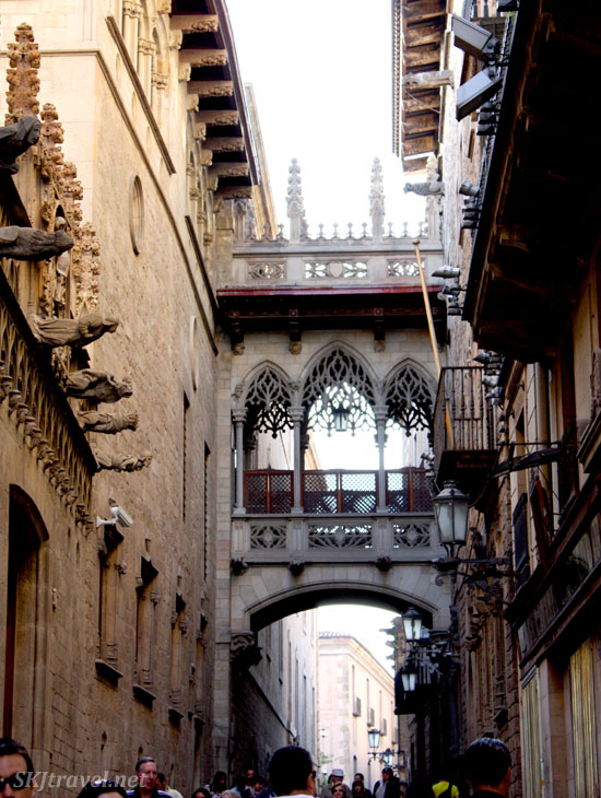 White bridge spans the two sides of a narrow alley in Barcelona. Photo by Shara Johnson