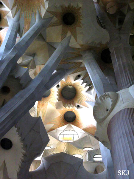 Ceiling of the Sagrada Familia showing natural light through a maze structures. photo by Shara Johnson