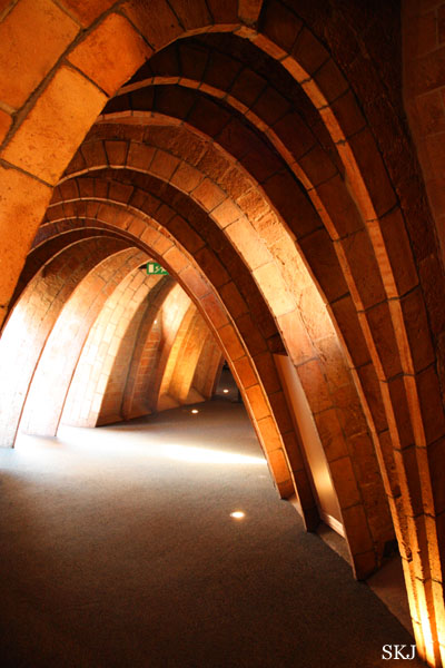 An attic-like space of closely-spaced brick arches lining a hallway in the Pedrera in Barcelona. Photo by Shara Johnson