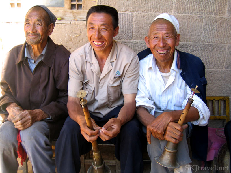 Three men with traditional instruments, horns and cymbals, who are part of a wedding band in a village in Shaanxi Province, China. Photo by Shara Johnson
