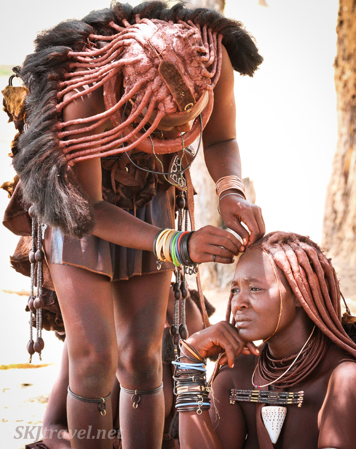 Princess Kaviruru working on her mother's hair. Kunene region of Kaokoland, Namibia.