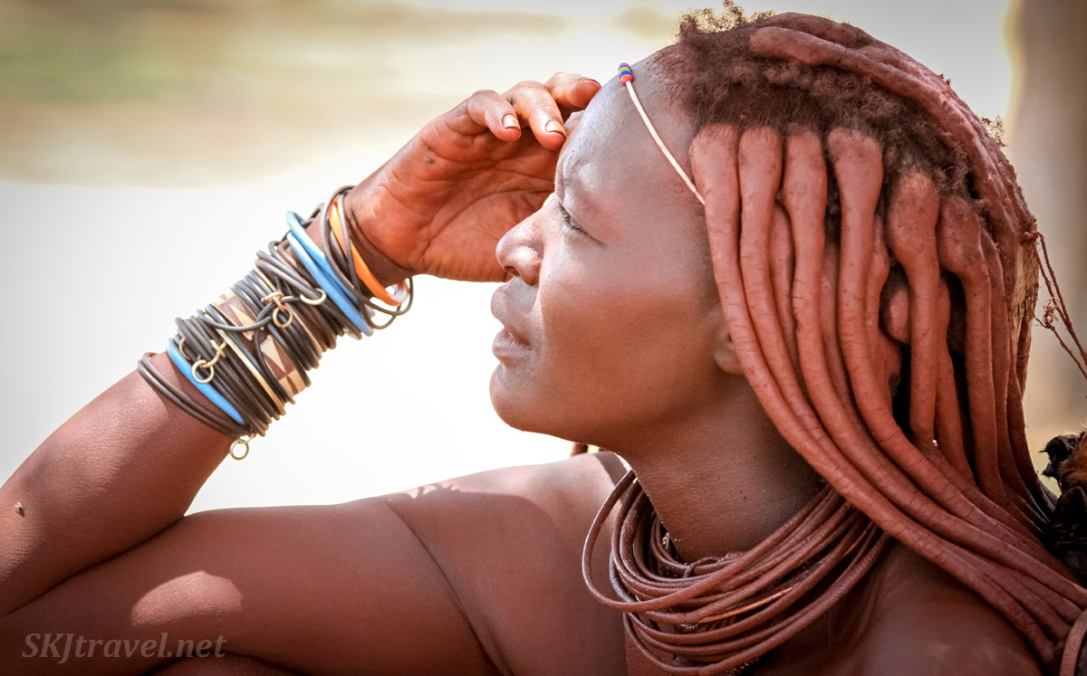 Himba woman in thought. Northern Namibia.