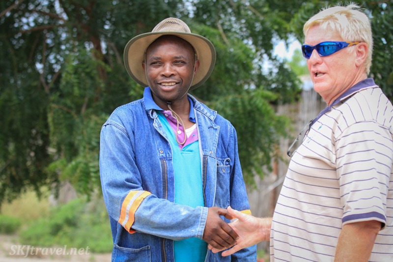 Village headman Coster shaking hands with Berrie in agreement to meet again soon. Northern Namibia.