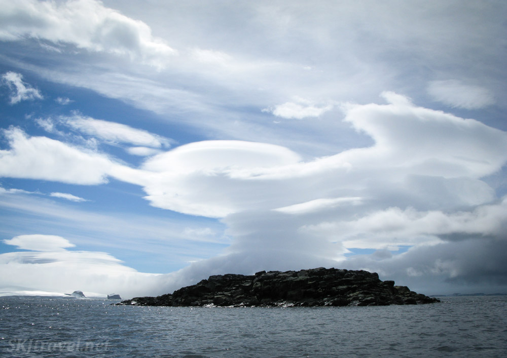 Rocks with interesting clouds, Southern Ocean, Antarctica.