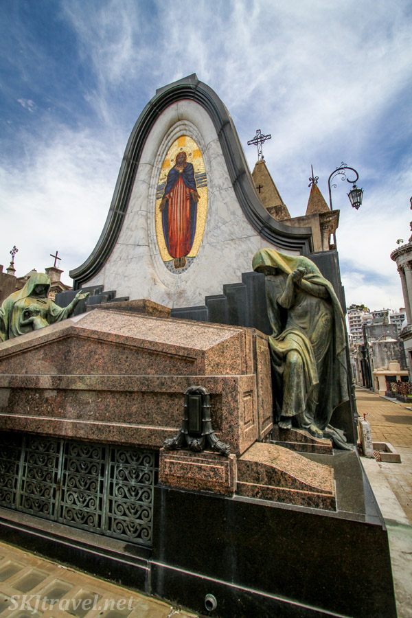 Marble tomb with bronze statues in Recoleta Cemetery, Buenos Aires, Argentina.