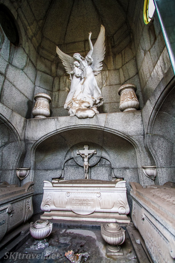 Elaborate coffins and stone sculptures inside mausoleum at Recoleta Cemetery, Buenos Aires, Argentina.