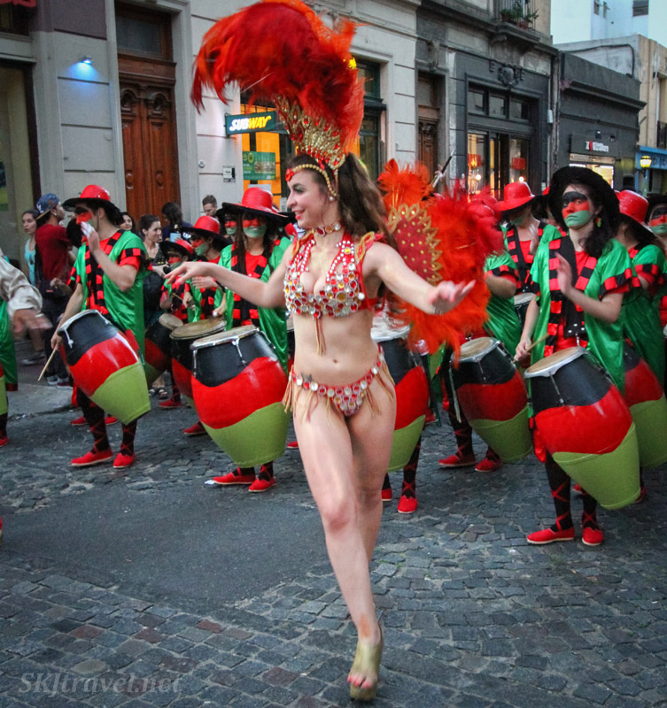 Comparsa dressed in matching costumes and makeup in the San Telmo Candombe parade, Buenos Aires, Argentina.