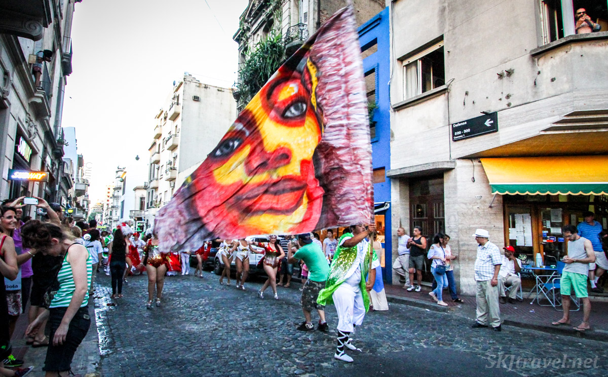 Comparsa flag, a woman's face, in the San Telmo Candombe parade, Buenos Aires, Argentina.