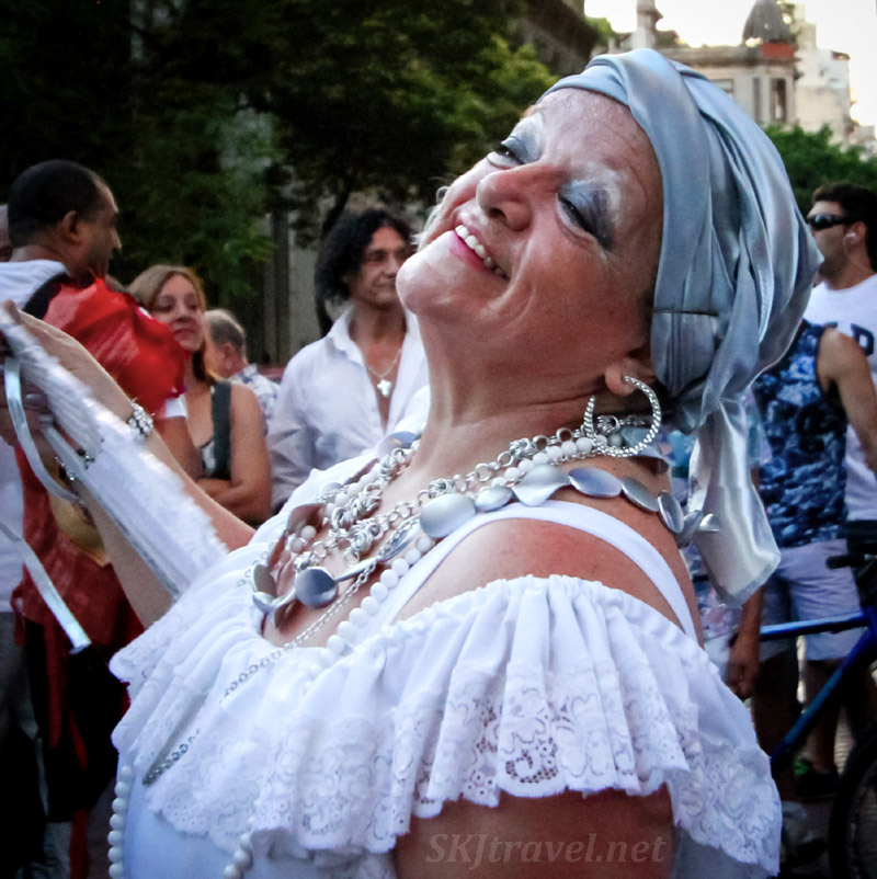 Mama Vieja character fanning herself and dancing in the streets at the San Telmo Candombe parade, Buenos Aires, Argentina.