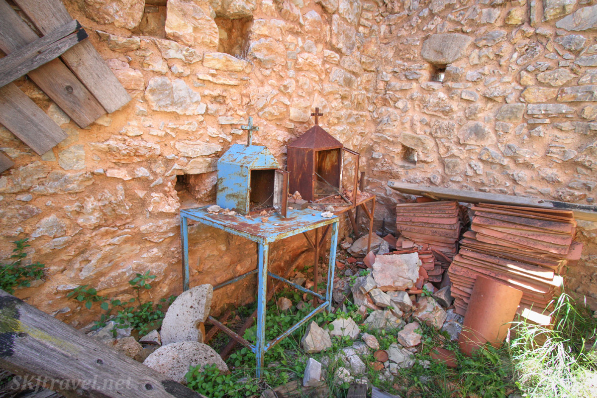 Rusting religious items abandoned in the hilltop fortified village of Anavatos, abandoned ruins, Chios Island, Greece.