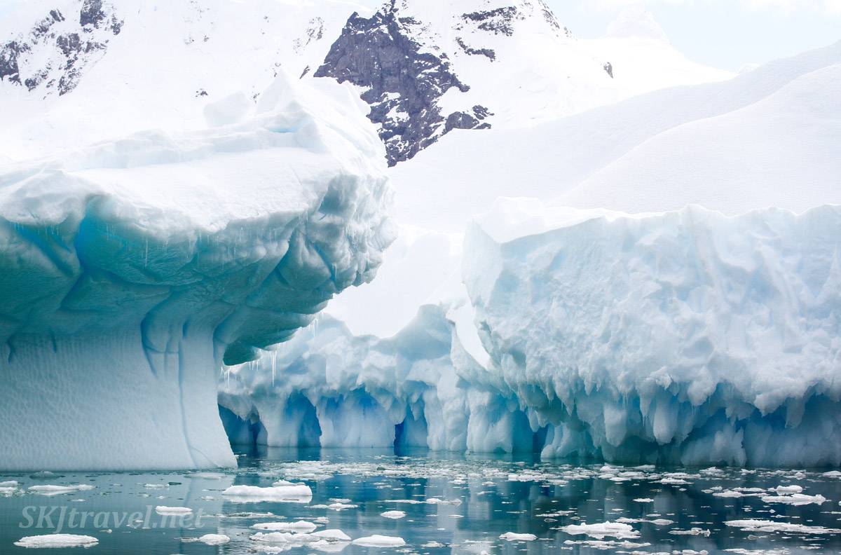 Corridor of water through icebergs (bergy bits) in the Southern Ocean, Cierva Cove, Antarctica.