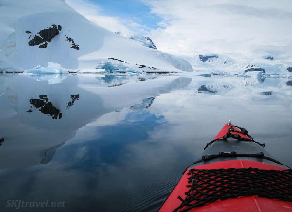 Kayaking at Cuverville Island, Antarctica. Reflections of land on the water.