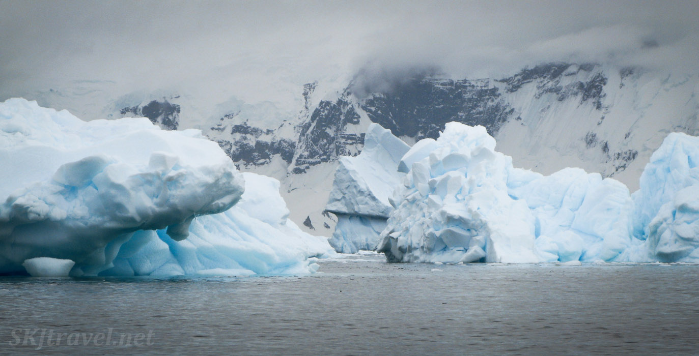 Passageway through large icebergs, kayaking at Cuverville Island, Antarctica.