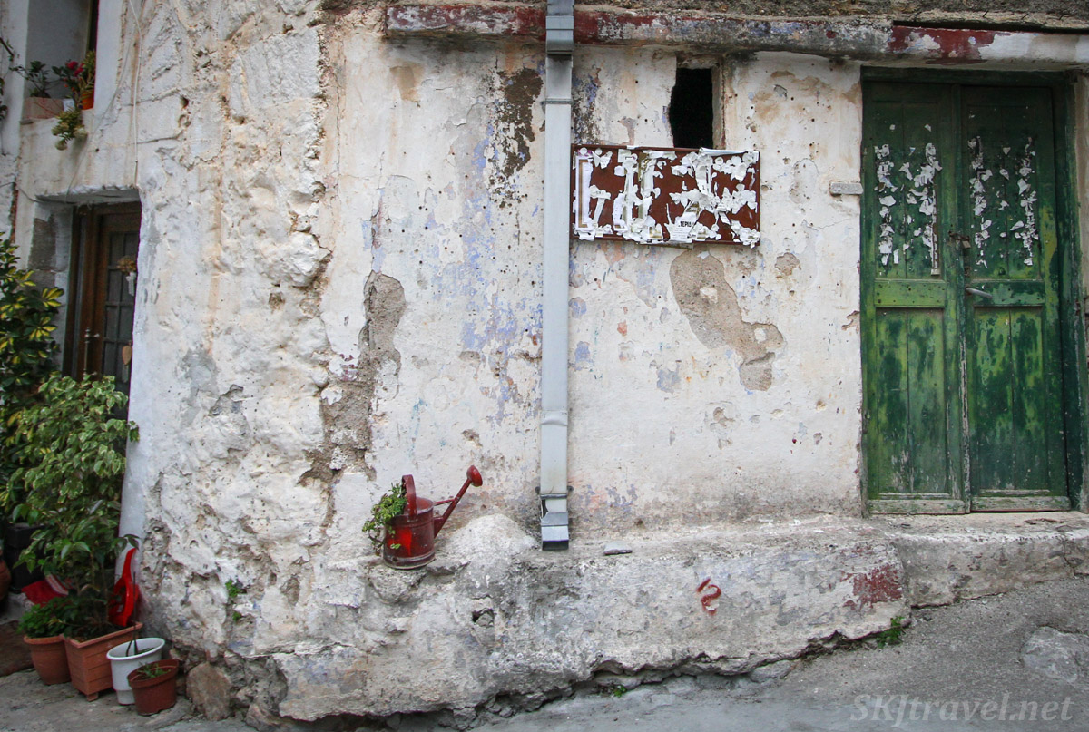 Flowers and watering can lend signs of life in the medieval labyrinth of streets in the mastic Mesta village, Chios Island, Greece.