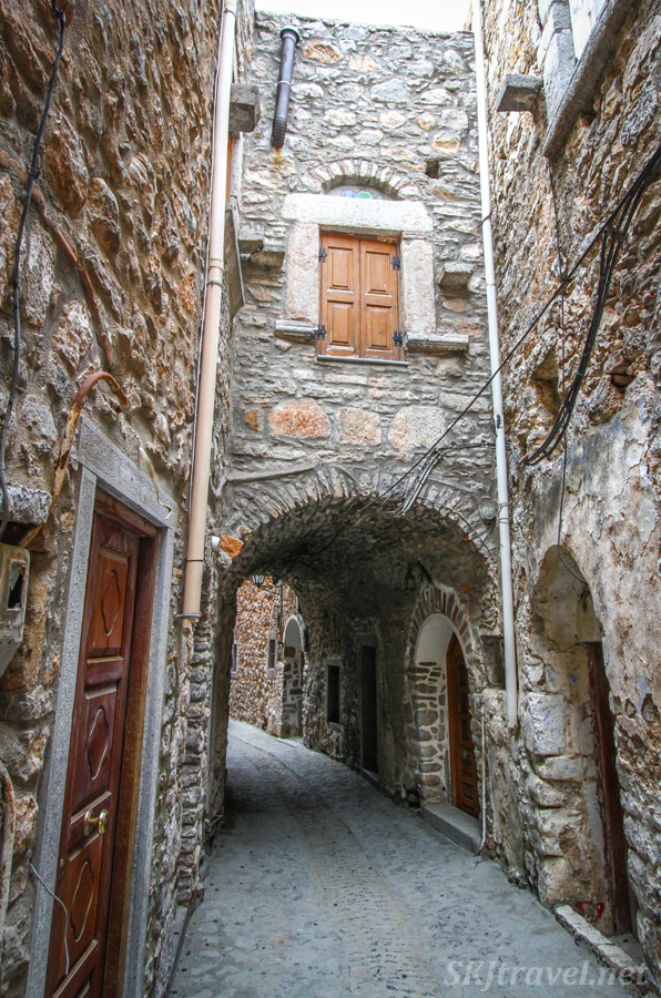 Stone archway in the medieval labyrinth of streets in the mastic Mesta village, Chios Island, Greece.