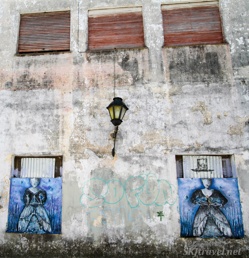 Abandoned cement building turned painter's canvas. Street art in Colonia del Sacramento, Uruguay.