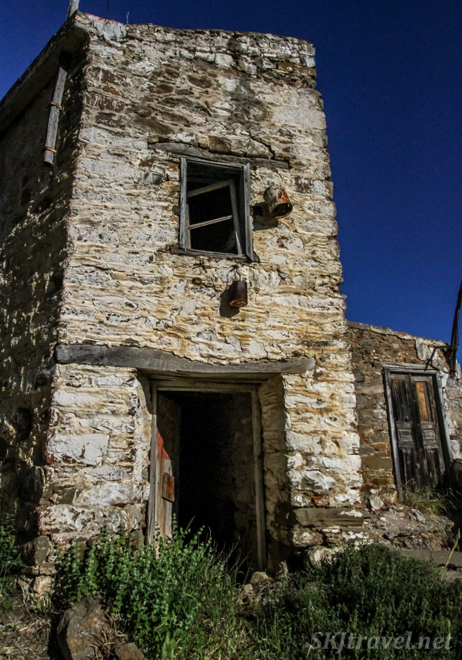 Abandoned stone tower, maybe a barn, with a bucket, Volissos, Chios Island, Greece.