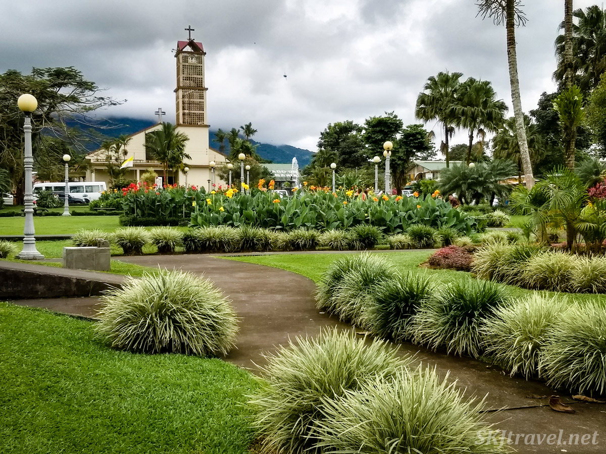 Central park with church in La Fortuna, Costa Rica.