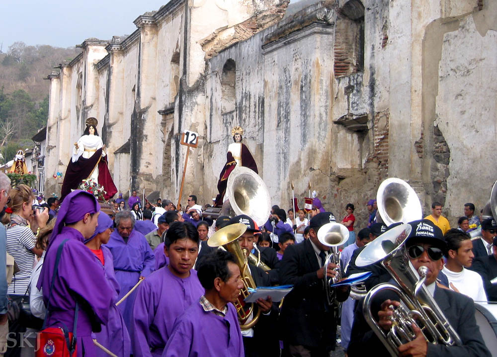 Brass band following the wooden floats through the streets of Antigua, Guatemala, for Semana Santa celebration. Good Friday morning.