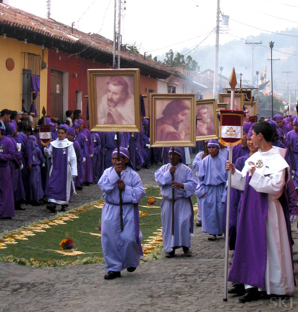 Purple clad men carrying banners, Semana Santa, Antigua, Guatemala.