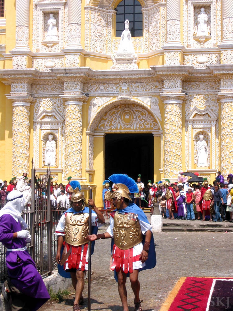 Men dressed as Roman soldiers, part of the Good Friday, Semana Santa, celebration outside La Merced cathedral, Antigua, Guatemala.