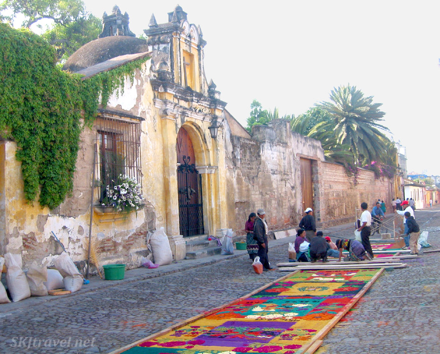 Making stenciled sand carpets on the cobblestone streets of Antigua, Guatemala, Thursday night before Good Friday. Semana Santa celebration.