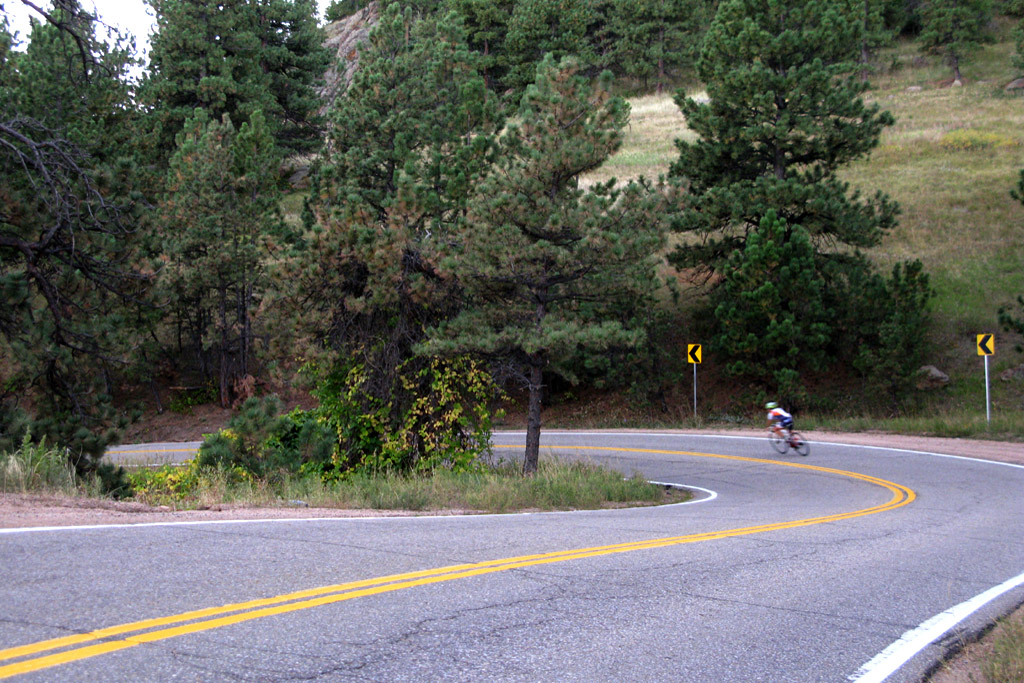 Bicyclists riding down Flagstaff Road, Boulder, Colorado.