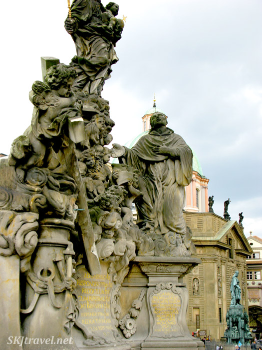 Stone statues as you exit the Charles Bridge on the town hall side. Prague.