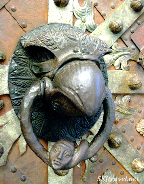 Detail of the eagle head door knob. Prague.